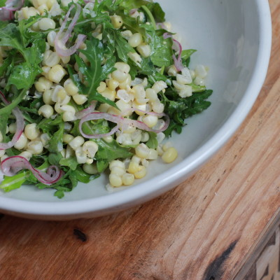 arugula and corn salad with pickled red onions