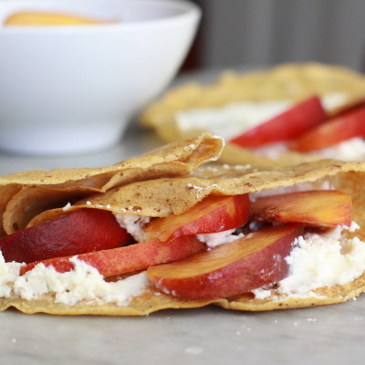 cinnamon crepes with peaches and cream