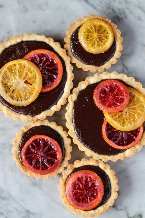 bittersweet chocolate tarts with candied oranges www.girlontherange.com
