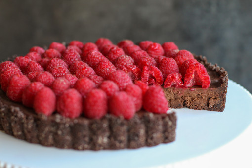 chocolate truffle tart with raspberries side slice www.girlontherange.com
