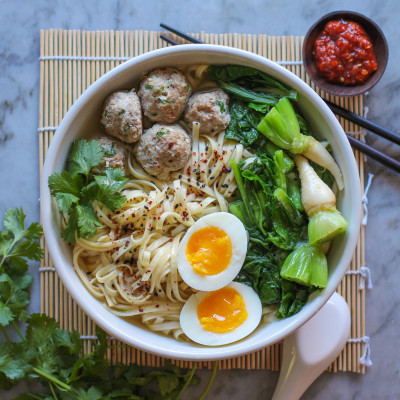 miso lemongrass turkey and turnip green noodle bowl